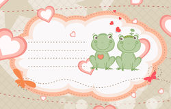 Frogs in love Stock Image