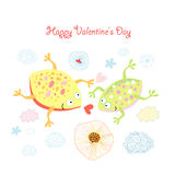 Frogs in love. Fun loving frogs on a white background with clouds Royalty Free Stock Photography