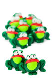 Frogs. Made of polymer clay isolated on white background Stock Photos