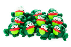 Frogs. Made of polymer clay isolated on white background Stock Image