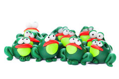 Frogs. Made of polymer clay isolated on white background Stock Photography