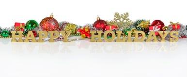 Frohe Feiertage goldener Text und Weihnachtsdekorationen Stockbild