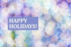 Frohe Feiertage Text auf unscharfem Hintergrund Stockbilder