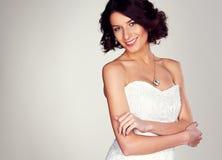 Frohe junge Braut Stockfoto