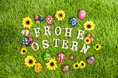 Frohe ostern eggs on grass Royalty Free Stock Images