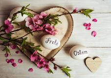Frohe Ostern written on eggs. Happy easter written in German on white eggs with flowers frohe ostern table handwritten calligraphy decorated holiday handicraft stock photography