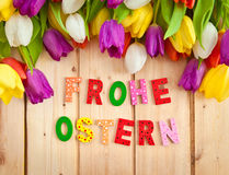 Frohe Ostern written in multicolored letters Stock Photo