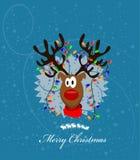 Frohe Weihnacht-Karte mit Ren Stockfotos