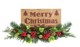 Frohe Weihnacht-Zeichen und Flora Decoration Lizenzfreie Stockfotografie