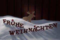 Frohe Weihnachten значит с Рождеством Христовым снег лосей Стоковые Фото