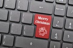 Frohe Weihnachten auf Tastatur Lizenzfreie Stockfotos
