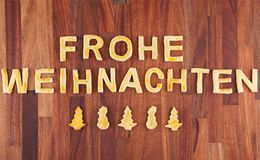 Frohe Weihnachten avec des biscuits Images stock
