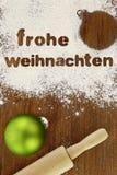 Frohe weihnachten el fondo de la hornada Foto de archivo libre de regalías