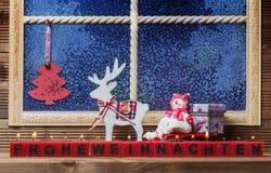 Frohe Weihnachten, Fensterdekorationen Lizenzfreies Stockfoto