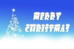Frohe Weihnachten geschrieben auf Kobaltblauhintergrund Stockbilder