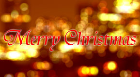 Frohe Weihnachten geschrieben auf unscharfen Hintergrund Stockbilder