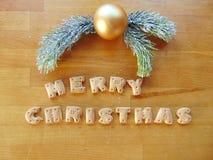 Frohe Weihnachten geschrieben mit Plätzchen Stockbilder