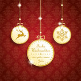 Frohe Weihnachten Golden Thaler Red Ornaments Stock Photography