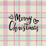 Frohe Weihnachten Handgemalte Beschriftung lokalisiert auf Plaidhintergrund Stockbilder