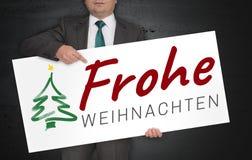 Frohe Weihnachten im deutschen Plakat der frohen Weihnachten wird vorbei gehalten Stockfoto