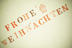 Frohe Weihnachten. Lettering stamp text royalty free stock image
