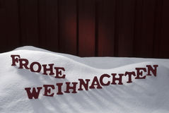 Frohe Weihnachten Means Merry Christmas On Snow Royalty Free Stock Photos