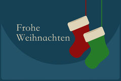 Frohe Weihnachten poster with Christmas Socks. Merry Christmas G Stock Photo