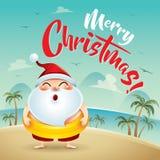 Frohe Weihnachten! Santa Claus auf dem Strandurlaub Stockbilder