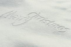 Frohe Weihnachten, Schneetext stockfotos