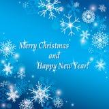 Frohe Weihnachten und guten Rutsch ins Neue Jahr - blauer Hintergrund Lizenzfreies Stockfoto