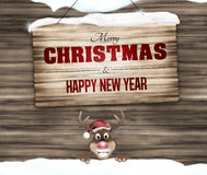 Frohe Weihnachten und guten Rutsch ins Neue Jahr des hölzernen Zeichens Stockbild