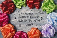 Frohe Weihnachten und guten Rutsch ins Neue Jahr des Textes Stockbilder