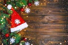 Frohe Weihnachten und guten Rutsch ins Neue Jahr Ein neues Jahr ` s Hintergrund mit Dekorationen des neuen Jahres Neues Jahr ` s  Stockfotos