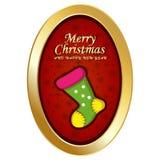 Frohe Weihnachten und guten Rutsch ins Neue Jahr mit ovalem Rahmen, rotem Hintergrund und Socken Stockfotografie