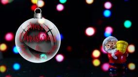 Frohe Weihnachten und guten Rutsch ins Neue Jahr Weihnachtsmanns Front mit Lichtern im Hintergrund stock video footage