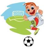 Froher Junge, der Fußball spielt lizenzfreie abbildung