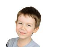 Froher Junge in einer grauen Strickjacke Stockfotos