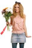 Frohes blondes Baumuster mit einem Blumenstrauß der Blumen Stockbilder