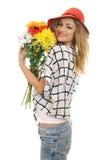Frohes blondes Baumuster mit einem Blumenstrauß von Blumen 3 Stockbilder