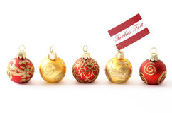 Frohes Fest. Christmas ornaments, one with German message Frohes Fest (Merry) Christmas, copyspace, shallow DOF Stock Image