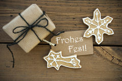 Frohes Fest on a Banner with Christmas Decoration Stock Photos
