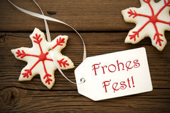 Frohes Fest on a Label with Christmas Star Cookies Stock Images