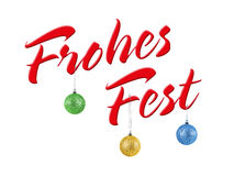 Frohes Fest Merry Christmas in German, Christmas lettering with Christmas balls Royalty Free Stock Photo