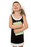 Frohes Kind mit einem Buch Stockbilder