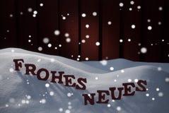 Frohes Neues significa Feliz Año Nuevo con los copos de nieve Imagen de archivo libre de regalías