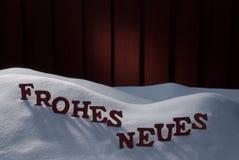 Frohes Neues significa Feliz Año Nuevo en nieve Imágenes de archivo libres de regalías