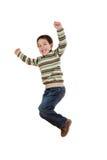 Frohes Springen des kleinen Mädchens Stockfoto