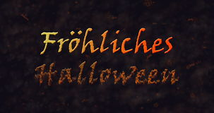 Frohliches Halloween text in German dissolving into dust to bottom Stock Photography