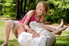 Frolic brother and sister. Happy family enjoying their free time in the park Royalty Free Stock Image