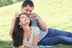 Frolic couple. Pretty frolic smiling couple fooling in grass meadow Stock Images